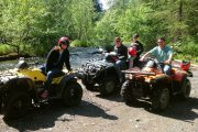 ATV adventurers break by the river