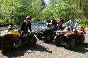ATV adventurers break by the river